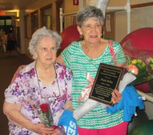 Effie Ann Tompkins and Paula Kelley, the winner of the 2015 Effie Ann Tompkins Community Service Award.