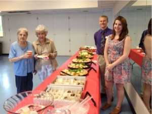 Interns William Goliger and Laura Fagan serve refreshments at a concert during a party at the Senior Center. (Photos/submitted)