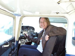 Christine Puliam, president of Experimental Aircraft Association Chapter 67, sits in the cockpit of an aircraft at Marlboro Airport. (Photo/submitted)
