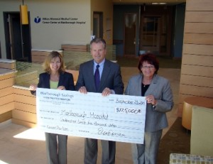 (l to r) Ellen Dorian, executive vice president, marketing and HR, and Rick Bennett, president and CEO, of Marlborough Savings Bank present the check to Candra Szymanski, interim president and CEO, Marlborough Hospital (Photo/submitted)
