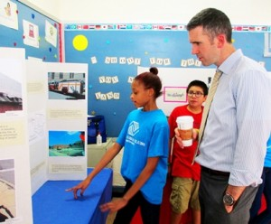 Boys & Girls Clubs of Metrowest member Meleah explains her project to Barry Keppard, public health manager for the Metropolitan Area Planning Council. (Photo/submitted)
