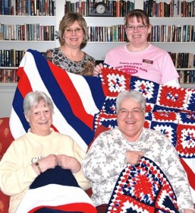 Displaying handmade items to be donated to Blankies for Boston are (front, l to r) Flo Chisholm and Sandra Wallace, residents at Christopher Heights; and (back, l to r) Patty Blodgett, activities director; and Kathy Hearns, a member of the Marlborough Junior Woman's Club. Photo/Ed Karvoski Jr.