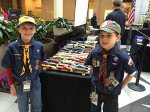 Alexander Bruno (l) and Zachary Jalbert, both of Hudson, checking out the competing race cars at the Regional Cub Scout Pinewood Derby. (Photo/submitted)