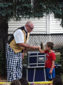 The Stupendous Mr. Magichead enlists the help of audience member, Jase, at the River's Edge Art Alliance Family Fun Festival.