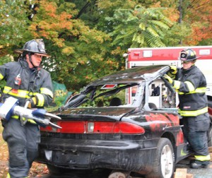 Firefighters John Verock and Joe Bisazza perform a vehicle extraction demonstration.
