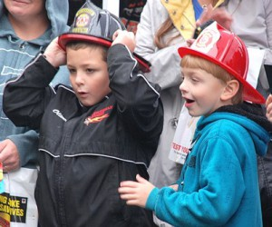 Oliver Harris, 8, and Todd Manning, 6, are amazed by a vehicle extraction demonstration.