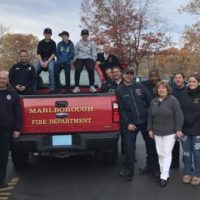 Members of 1714 IAFF and their families pose for a photo before delivering Thanksgiving dinner to members of the community.