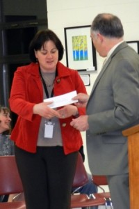 Gabrielle Abrams, executive director of primary and elementary education at Marlborough Public Schools, receives $3,900 for an anti-bullying presentation from Ronald Brault, Brigham Family Trustee.