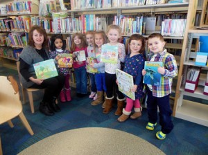 The preschool students and their teacher, Barbara Cooper, from Happy Hours Preschool, enjoy their monthly visit to the Marlborough Library. (Photo/Nance Ebert)
