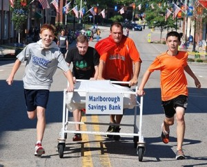 Finishing a close second place in 1:49 is the team sponsored by Marlborough Savings Bank consisting of representatives from the Marlborough High School cross country team: (l to r) Jeremy Bonds, sophomore; Sheldon Vigeant, coach; Jeff Downin, coach; and Owen Crisafulli, freshman.