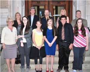 Gathered at Marlborough City Hall are (back, l to r) Youth Commission members Kelley French, Pascal Chesnais, Mike Gibson, Connie Mish, and Mayor Arthur Vigeant, (front, l to r) City Council President Trish Pope, and Youth Service Award recipients Sydney Teele, Jaelyn Kassoy, Christina Furtado, Joey Ciolino and Paige Lariviere. (Not pictured are Alysha McGovern, award recipient; and Steve Zepf, commission member.) Photo/Ed Karvoski Jr.