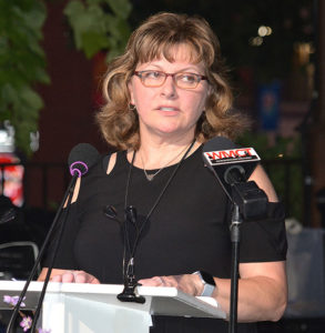 Kathy Leonard welcomes everyone to the fourth candlelight vigil that she coordinated. Photos/Ed Karvoski Jr.