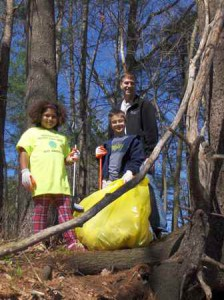 (l to r) Stella Benway and Carter and Troy Siebels participate in the Earth Day Cleanup at Fort Meadow Reservoir. (Photo/submitted)