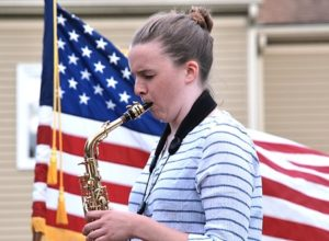 "Sarah Hanahan plays ""The Star-Spangled Banner"" on saxophone."