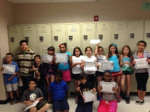 Winning science fair teams show off their certificates.