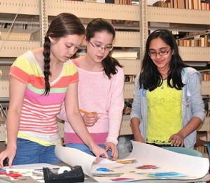 Participating in the Teen Room Design Workshop, held April 22 at the Marlborough Public Library, are Advanced Math & Science Academy students (l to r) Heather Wing, a freshman; her sister, Chloe, a sixth-grader; and Sandhya Sangappa, a sixth-grader. Photo/Ed Karvoski Jr.