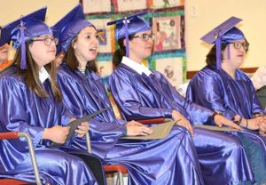 (l to r) Caitlyn Kline, Samantha Grimaldo, Paula Cezar and Kristen Camacho listen to a speaker. Photos/Ed Karvoski Jr.