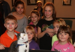 (Front, l to r) Elliot, 6, Nora, 4, Samantha, 6, (Back, l to r) Nina, 9, Michaela, 6, Amelia, 9, and Aubrey, 5, pose with Toto.