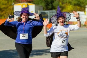 Corey Robinson (left) and Kelly Nolan celebrate as they approach the finish of the Trick or Trot 5K.
