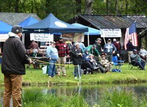 Veterans and volunteers fish and mingle at the Marlborough Fish & Game Association pond. Photos/Ed Karvoski Jr.