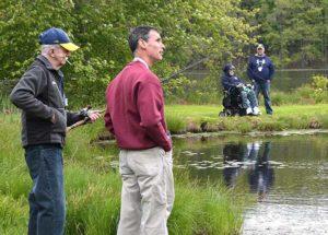 Veterans and volunteers pair by the pond. Photos/Ed Karvoski Jr.