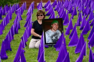 Kathy Leonard, who is organizing the vigil, with a photo of her son Jonathan, who died of an overdose in December 2014