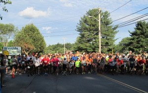 Runners take off at the starting line of the Run for Fun 5K road race hosted by Wayside Racquet and Swim Club.