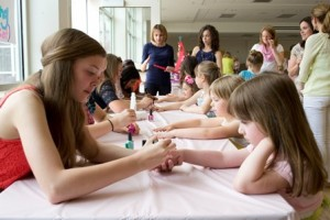 The daughters got their nails painted at the Mother/Daughter Tea Party.