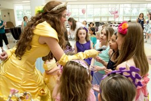 """The Disney Princess, """"Belle,"""" dances and sings with the daughters."""
