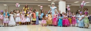 """The Disney Princesses, """"Belle"""" and """"Cinderella,"""" gather all the daughters together for a group picture."""