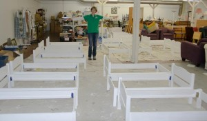 Director of Fresh Start Furniture Bank Sue Waudby stands among the completed toddler beds. (Photo/submitted)