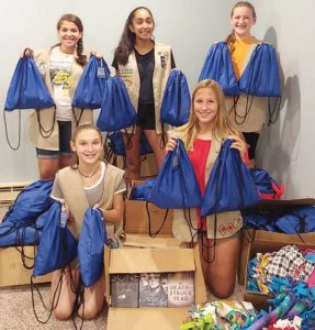 Girl Scouts from Marlborough and Hudson with the bags they put together for local foster children. Photo/submitted