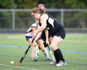 : Westborough's #7 Mridhu Khanna fight to prevent #2 Christina Leonard from progressing down the field past her.