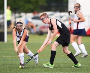 Westborough's Lindsey Bromm #15 gains possession of the ball from #10 Connor Hennessy.