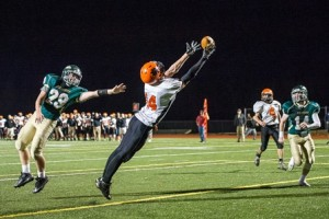 Marlborough High School's Joe Tirpak just misses this touchown late in the second quarter as Nashoba Regional High School's Jake Fire defends at left.
