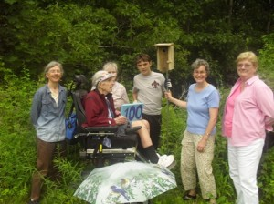 The team prepares to install the 100th bluebird house.