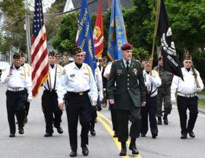 Gerard Bourque and Bruce Goldsmith lead the Vincent F. Picard American Legion Post 234 Color Guard, approaching the World War II / Korean War / Vietnam War Memorial. Photos/Ed Karvoski Jr.
