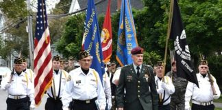 Gerard Bourque and Bruce Goldsmith lead the Vincent F. Picard American Legion Post 234 Color Guard, approaching the World War II / Korean War / Vietnam War Memorial. Photos/Ed Karvoski Jr.