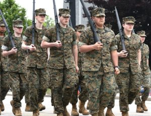 Marine Corps JROTC cadets of Assabet Valley Regional Technical High School march on Main Street.