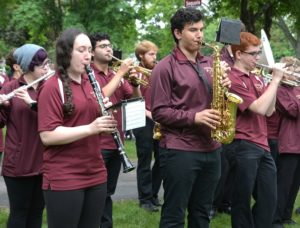 Algonquin Regional High School Band musicians play the national anthem.