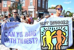 Algonquin Regional High School students carry a Best Buddies banner. Photos/Ed Karvoski Jr.