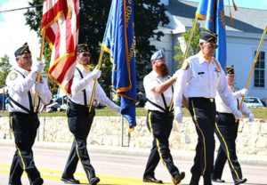 Bruce Goldsmith leads the Vincent F. Picard American Legion Post 234 Color Guard. Photos/Ed Karvoski Jr.