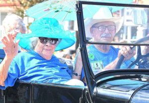 Passengers ride a 1926 Ford Model T sponsored by SALMON Health and Retirement. Photos/Ed Karvoski Jr.
