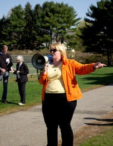 """Michelle Gillespie, the president of the Rotary Club of Northborough and an organizer for the """"Northborough Gets Active"""" 5K Road Race and Walk, greets the runners at the start of the race."""