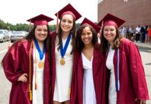 Abby Chan, Emily Genga, Naraylee Baez and Lauren Seavey pose prior to the Algonquin Regional graduation ceremony. Photo/Jeff Slovin