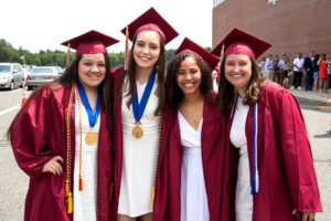 Abby Chan, Emily Genga, Naraylee Baez and Lauren Seavey pose prior to the Algonquin Regional graduation ceremony. Photo/Jeff Slovin