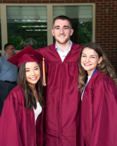 Catherine Lee, Nick Redden and Taylor Fenerty pose prior to the Algonquin Regional graduation ceremony. Photo/Jeff Slovin