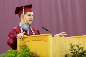 Senior Class President Matthew White addresses the crowd gathered at the Algonquin Regional graduation ceremony. Photo/Jeff Slovin