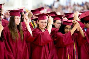 Graduates flip their tassels to the left to commemorate receiving their diplomas. Photo/Jeff Slovin