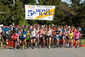 Runners take off at the start of the Corridor Nine Area Chamber of Commerce Applefest 5k Road Race. Photo/Jeff Slovin